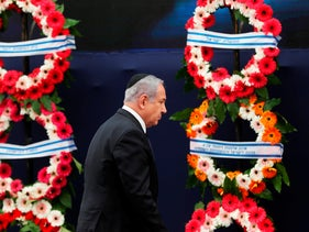 Israeli Prime Minister Benjamin Netanyahu walks past wreaths during a ceremony marking Memorial Day, at a monument in Jerusalem, May 7, 2019.