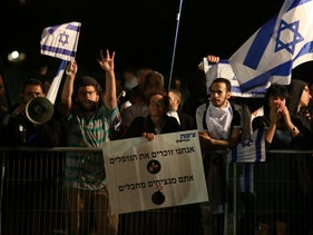 Right-wing protesters demonstrate against a joint Israeli-Palestinian Memorial Day event in Tel Aviv, May 7, 2019.