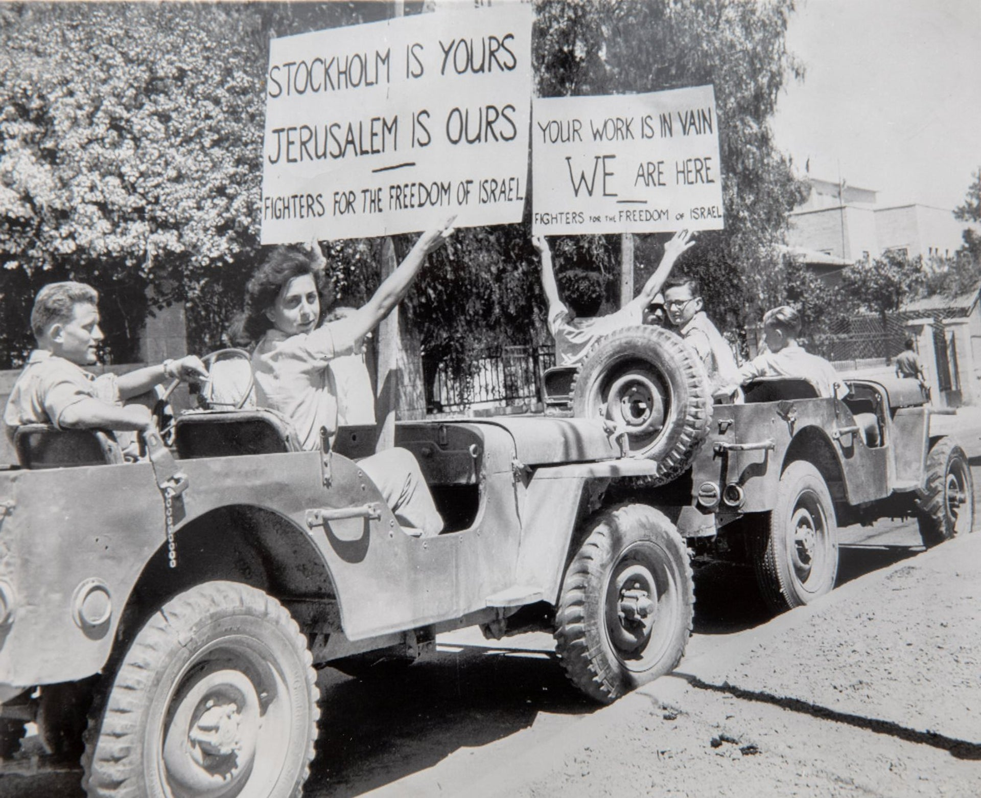 Members of the Lehi Pre-state underground militia display placards from jeeps parked near the Belgium Consulate in Jerusalem as they await the arrival of Count Folke Bernadotte, UN Palestinian Mediator, August 20 1948.