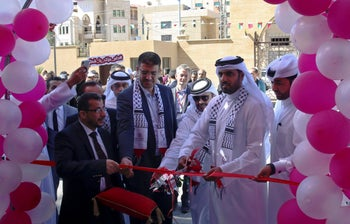 Khalifa al-Kuwari, director of the Qatar Fund for Development, cuts the ribbon during the opening ceremony of a new hospital in Gaza City, April 22, 2019.