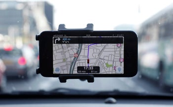 Waze, an Israeli mobile satellite navigation application, is seen on a smartphone