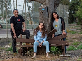 Eitan Zamir, left, Zohar Vered and Orly Zohar, who lost fathers or a husband while the loved one was serving in the Israeli army, April 2019.