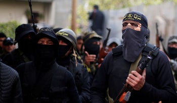 Islamic Jihad militants attend the funeral of Palestinian Jehad Hararah who was killed at the Israeli-Gaza border fence, March 23, 2019.