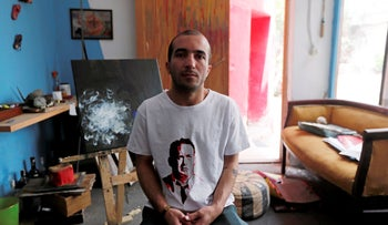 Artist and ex-political convict Yassin Mohamed wears a handmade T-Shirt with a drawing of Tom Hanks at his studio in Cairo, Egypt  April 24, 2019.