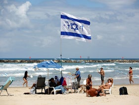 Israelis sit and play on the beach as Israel celebrates its Independence Day marking the 71st anniversary of the creation of the state, in Tel Aviv, Israel, May 9, 2019.