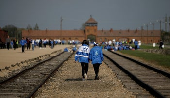 """File photo: Participants attend the annual """"March of the Living"""" to commemorate the Holocaust at the former Nazi concentration camp Auschwitz near Oswiecim, Poland, May 2, 2019."""