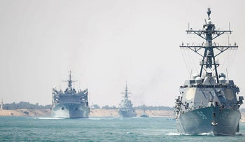 In this Thursday, May 9, 2019 photo released by the U.S. Navy, the Abraham Lincoln Carrier Strike Group transits the Suez Canal in Egypt