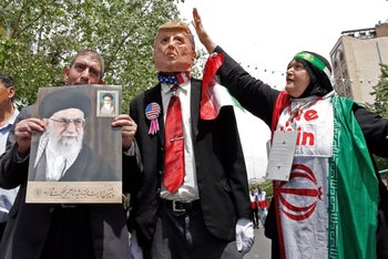 Iranian demonstrators carry a portrait of Iran's Supreme Leader Ayatollah Ali Khamenei and an effigy of US President Donald Trump during a rally in the capital Tehran, on May 10 2019.