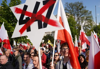 Far right demonstrators protest against the U.S. Senate's 447 bill, a law intended to support the restitution of Jewish property abandoned after the Holocaust, in Warsaw on May 11, 2019.