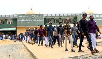 Sri Lankan Muslims come out Mohideen Meththai Grand Jumma Mosque after the Friday noon prayer in Kattankudy on April 26, 2019.
