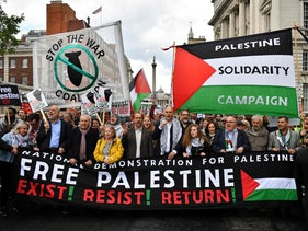 Palestinian activist Ahed Tamimi (centre right) joins a march calling for justice for Palestinians on Witehall in central London on May 11, 2019.