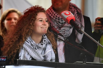Palestinian activist Ahed Tamimi speaks at a rally calling for justice for Palestinians in central London on May 11, 2019.