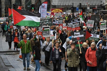A march calling for justice for Palestinians amid a growing threat of further war in the Middle East moves through the streets of central London on May 11, 2019.