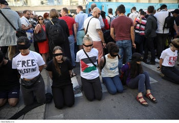Peace activists protest before the presentation of the 2019 Eurovision Song Contest participants in Tel Aviv, Israel, May 12, 2019.