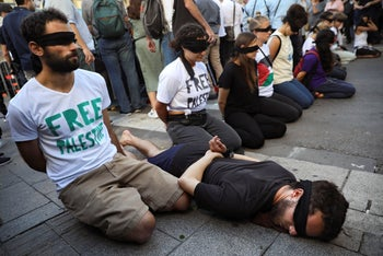 Peace activists protest before the presentation of the 2019 Eurovision Song Contest participants in Tel Aviv, Israel, Sunday, May 12, 2019.