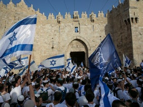 The Jerusalem Day flag march through the Old City's Damascus Gate, 2016.