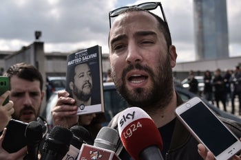 Francesco Polacchi, founder of the Altaforte publishing house, who defines himself openly as a fascist, presents books to the media outside the gates of the International Book Fair in Turin, Italy May 9, 2019