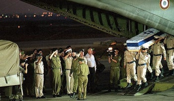 Israel Defense Forces soldiers carrying the coffin of Sgt. Itamar Ilya, one of the members of the elite Shayetet naval commando unit who was killed in a raid in Lebanon on September 4, 1997.