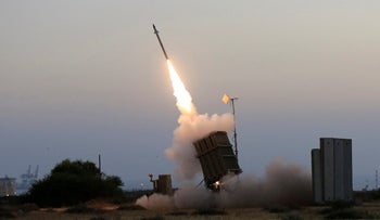 The Iron Dome air defense system fires to intercept a rocket from Gaza in Ashkelon, July 5, 2014.