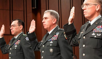 From left, Lt. Gen. Ricardo S. Sanchez, commander on the ground in Iraq, Gen. John Abizaid, head of U.S. Central Command and Maj. Gen. Geoffrey Miller, deputy commander of prison operations in Iraq, are sworn in to testify before the Senate Armed Services Committee on Capitol Hill about Iraqi prisoner abuse, May 19, 2004