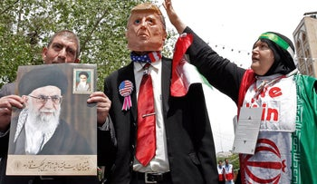 File photo: Iranian demonstrators carry a portrait of Iran's Supreme Leader Ayatollah Ali Khamenei and an effigy of U.S. President Donald Trump during a rally in the capital Tehran, May 10, 2019.