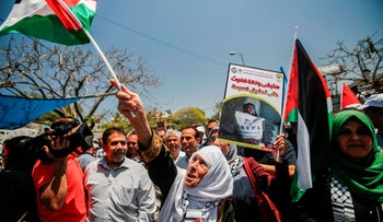 Demonstrators wave Palestinian flags as they march during a demonstration commemorating the 71st anniversary of the Nakba in Gaza City, May 14, 2019.