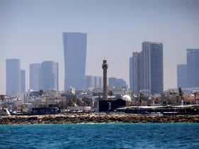 The minaret of the Hassan Bek Mosque is seen behind the Eurovision Village, an area for fans of the 2019 Eurovision Song Contest, Tel Aviv, Israel May 12, 2019.