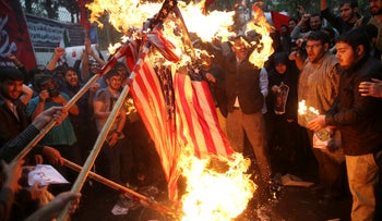Iranian protesters burn American flags, Tehran, May 9, 2018.