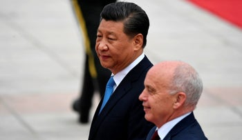 File photo: China's President Xi Jinping (L) and Switzerland's President Ueli Maurer walk together during a welcoming ceremony at the Great Hall of the People in Beijing on April 29, 2019.