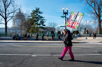 Anti-abortion activists march with a placards and chant in front of the US Supreme Court in Washington, D.C. January 22, 2015