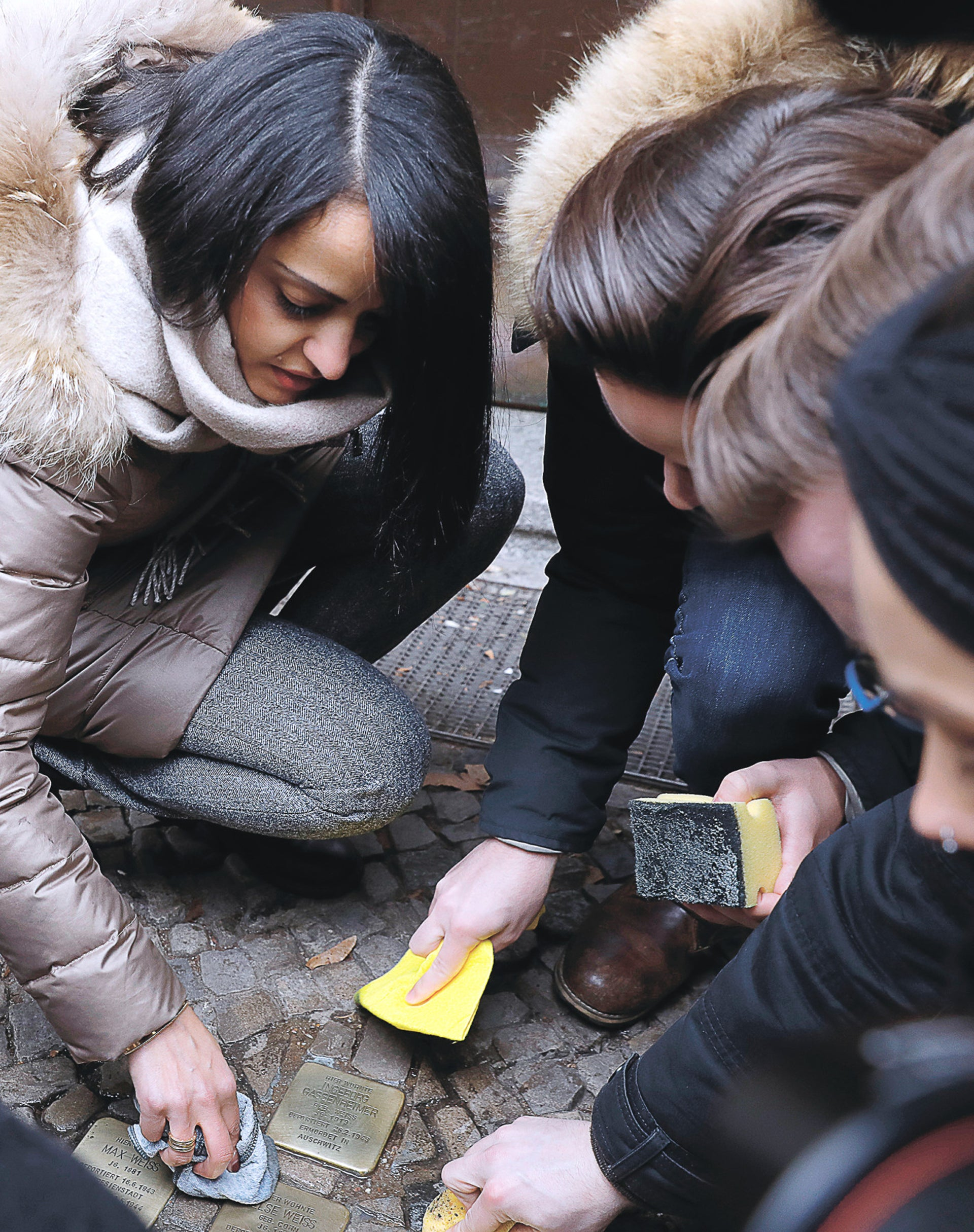 Sawsan Chebli cleaning Stolpersteine memorials to Jewish Holocaust victims, in Berlin last year.