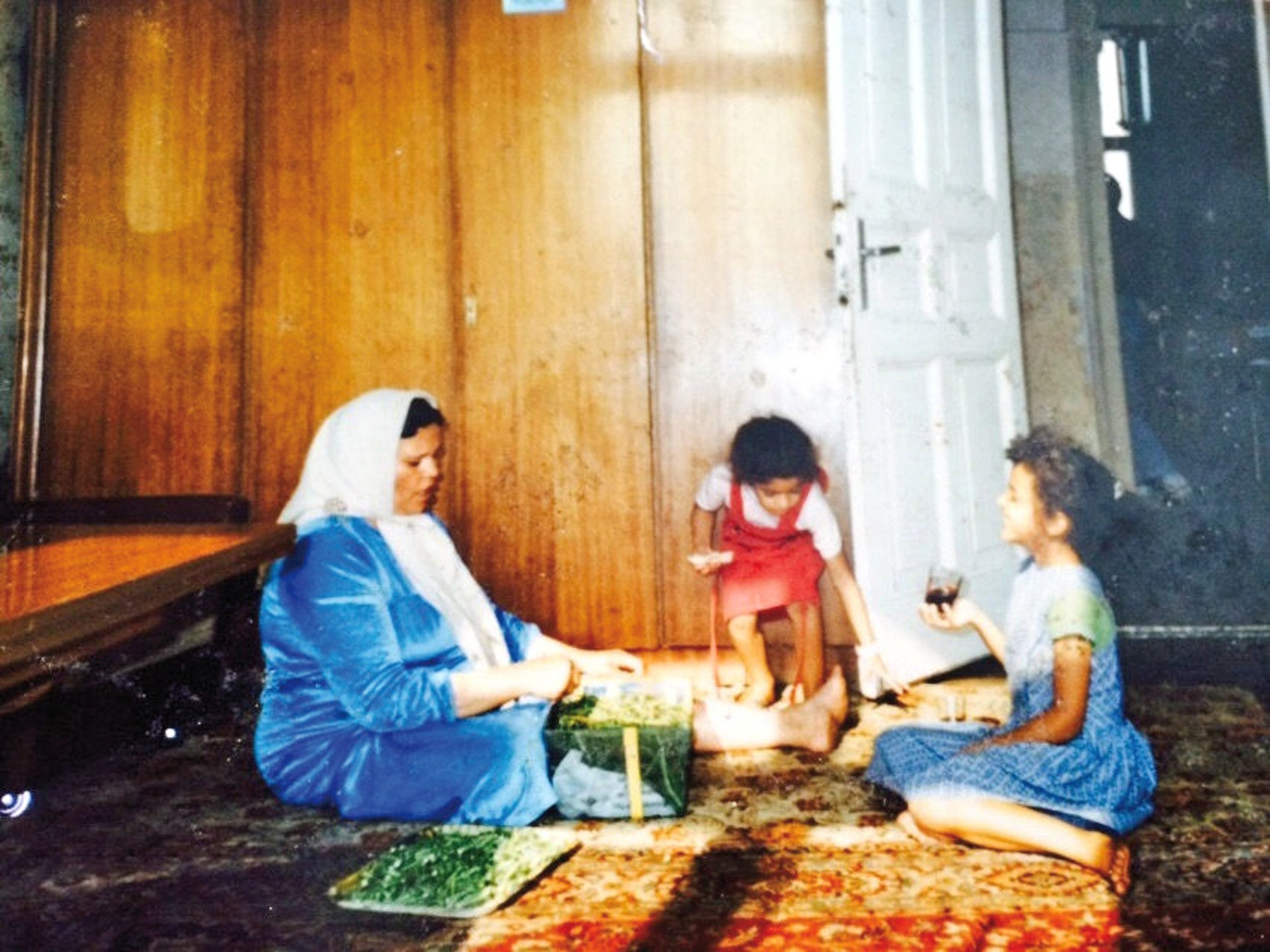 "Chebli, at right, with her mother and younger sister, as a child in Berlin's Moabit neighborhood. ""Politics has shaped the whole course of my life."""