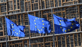 EU flags fly in front of the European Council in Brussels on May 14, 2019.