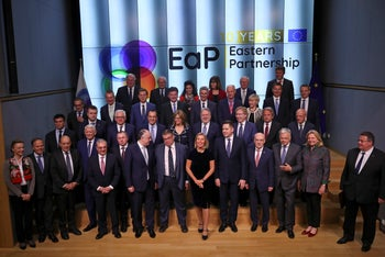 European Union foreign ministers and their Eastern Partners pose for a group photo at the Europa building in Brussels, Monday, May 13, 2019.