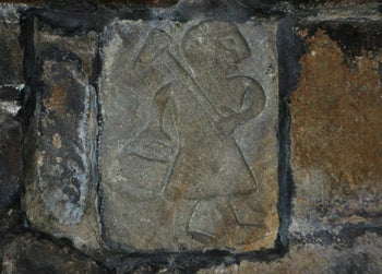 An Anglo Saxon carving from Bonsall church, depicting a lead miner, near Wirksworth, Derbyshire, U.K.