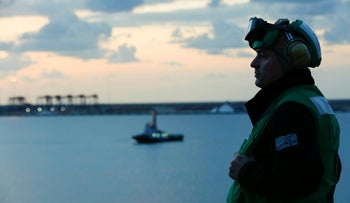 File photo: In this Thursday, May 9, 2019 photo released by the U.S. Navy, Aviation Maintenance Administrationman 2nd Class Jason Caldwell observes sunrise on the flight deck of the Nimitz-class aircraft carrier USS Abraham Lincoln while transiting the Suez Canal.