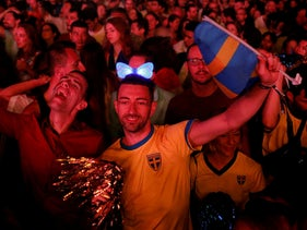 Fans react as they listen to the 2019 Eurovision song contest final in the fans zone by the beach in Tel Aviv, Israel, May 18, 2019.