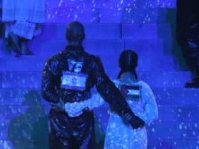 Dancers wearing Israeli and Palestinian flags link arms during Madonna's performance at the Eurovision Song Contest in Tel Aviv, May 18, 2019.