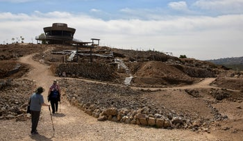 Tourists visit the archaeological site of Tel Shiloh in the West Bank, March 12, 2019.