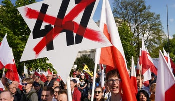 Several thousand far right demonstrators protest against the US Senate's 447 bill that supports the restitution of Jewish property abandoned after the Holocaust. Warsaw, Poland. May 11, 2019