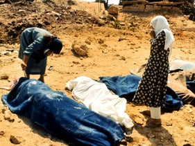 Two women inspect the bodies of Palestinians killed in the Sabra and Shatila massacre, three days after the killings by Lebanese Christian falangists. September 18,1982