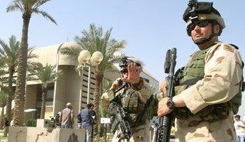 "FILE PHOTO: U.S. soldiers secure the area around the palace in the so-called ""Green zone"" in Iraqi capital Baghdad, May 19, 2004."