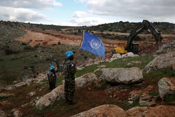 UN peacekeepers observe Israeli excavators attempt to destroy tunnels built by Hezbollah that crossed the U.N.-drawn Blue Line between Lebanon and Israel. Near Mays al-Jabal, Lebanon. Dec. 13, 2019