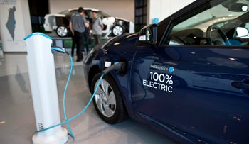 File photo: An electric car is displayed at the headquarters of electric car venture Better Place in Tel Aviv, October 10, 2012.