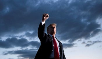 US President Donald Trump holds up his fist as he leaves after speaking during a Make America Great Again rally at Williamsport Regional Airport May 20, 2019, in Montoursville, Pennsylvania