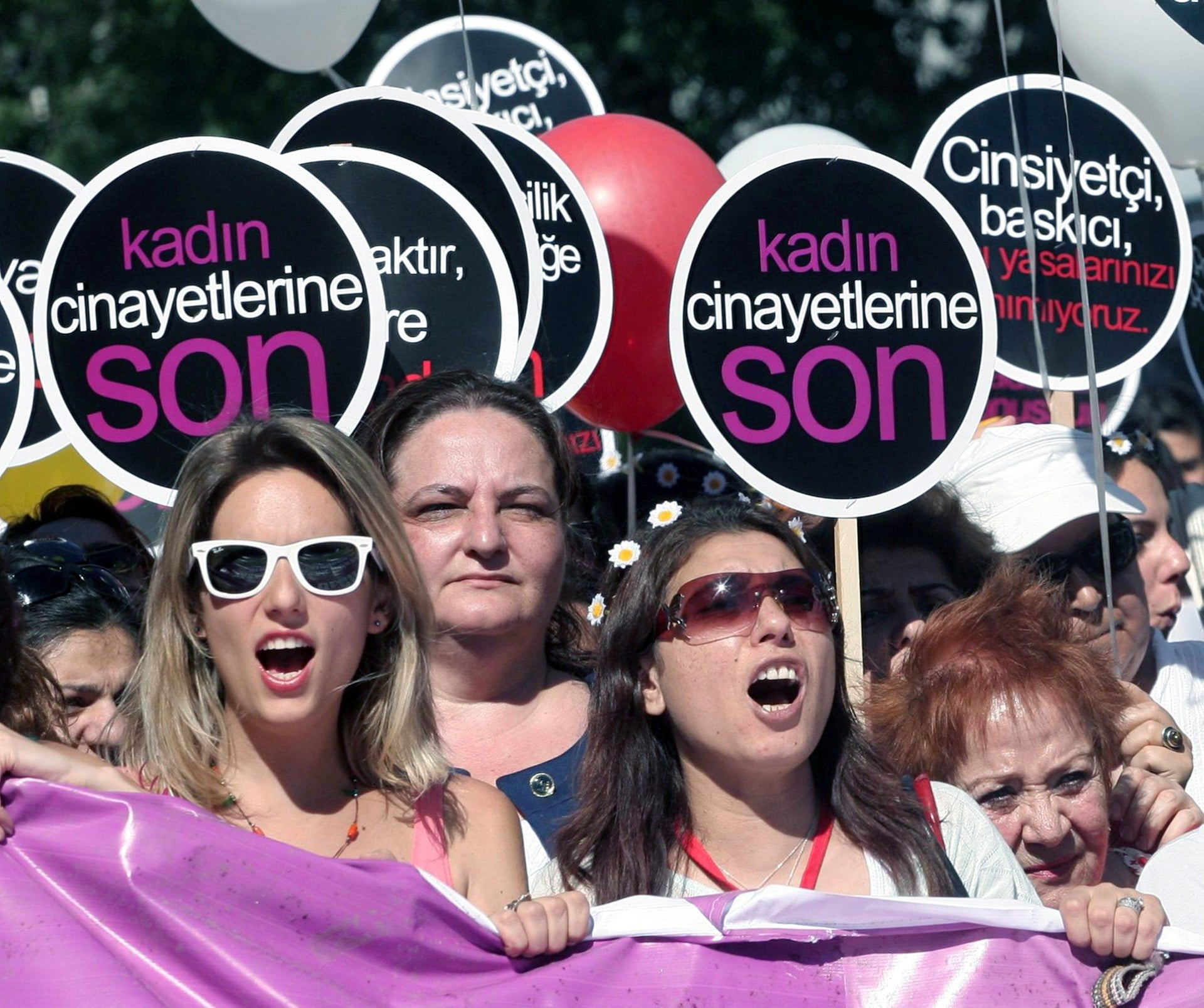 "Turkish women marching in Ankara in 2012 to protest a government plan to ban abortions. The slogan reads ""End woman killings."""