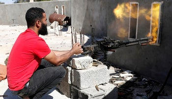 File photo: A fighter loyal to Libyan government fires a heavy machine gun during clashes with forces loyal to Khalifa Haftar at outskirts of Tripoli, May 16, 2019.