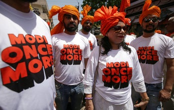 April 23, 2019 supporters of the Bharatiya Janata Party (BJP) wear T-shirts supporting Indian Prime Minister Narendra Modi in Bhopal.