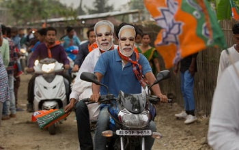 Bharatiya Janata Party (BJP) supporters wear masks of Indian Prime Minister Narendra Modi ahead of general elections in Borhola village, Assam state, India. April 2, 2019