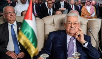 Palestinian President Mahmoud Abbas, right, and secretary general of the Palestinian Liberation Organization, Saeb Erekat, attend the the 30th Arab Summit in Tunis, Tunisia, March 31, 2019.